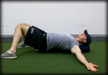 Lying knee-to-knee stretch to correct capsular restrictions