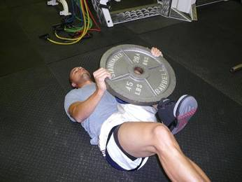 one-leg hip lift with weight plate